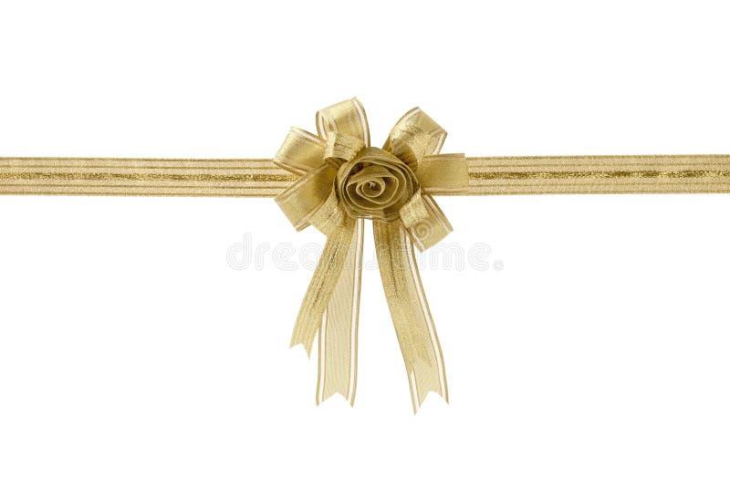 Fita e curva do presente do ouro, isoladas no fundo branco imagens de stock royalty free