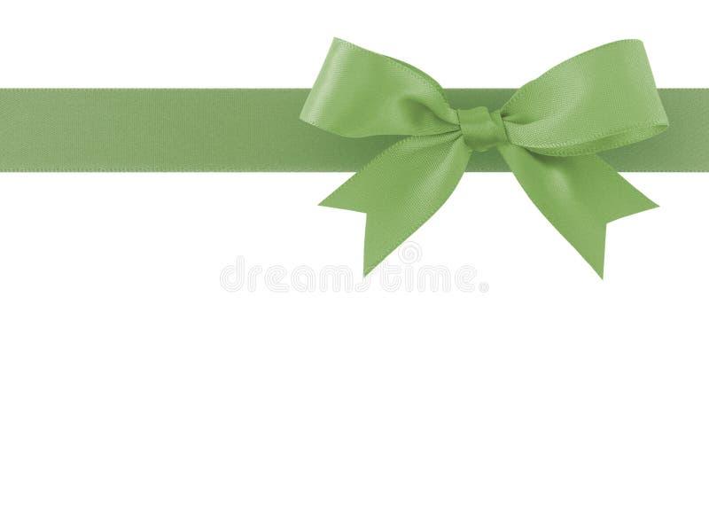 A fita verde com a curva isolada no fundo branco, decoração da simplicidade para adiciona a beleza à caixa de presente e ao cartã imagens de stock royalty free