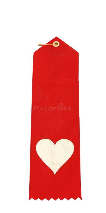 Fita vermelha com coração fotos de stock royalty free