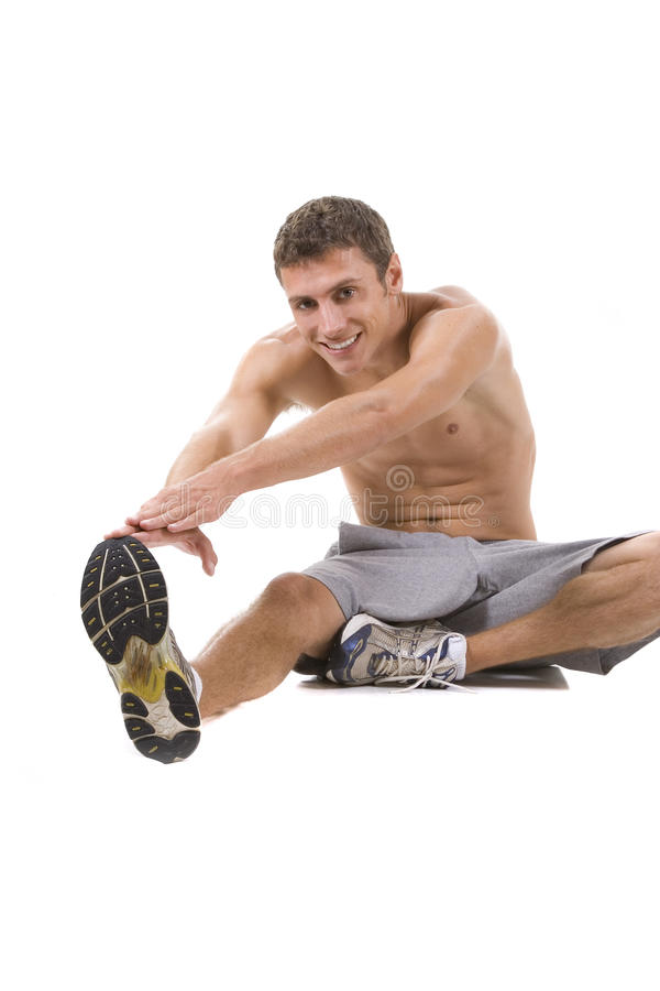 Fitness. Man on a white background in a fitness pose royalty free stock photo
