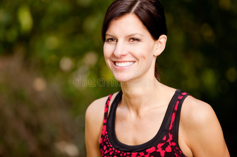 Fitness. A happy fitness woman in the park - lifestyle portrait stock image