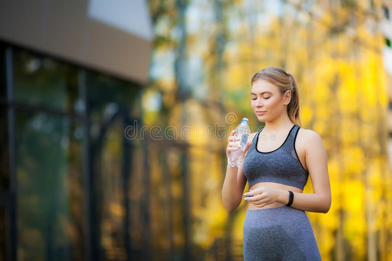 Fitness. Athlete girl, thlete exercise at outside, woman fitness. Young Beautiful Woman Stretching In The Park royalty free stock image
