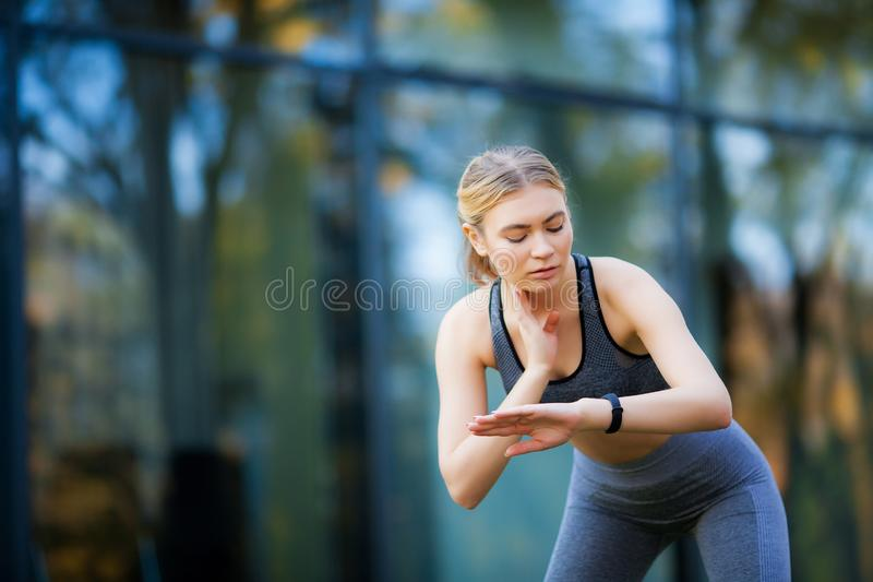Fitness. Athlete girl, thlete exercise at outside, woman fitness. Young Beautiful Woman Stretching In The Park royalty free stock photo