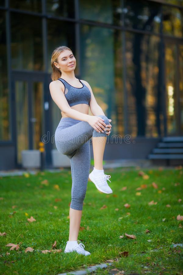 Fitness. Athlete girl, thlete exercise at outside, woman fitness. Young Beautiful Woman Stretching In The Park stock image