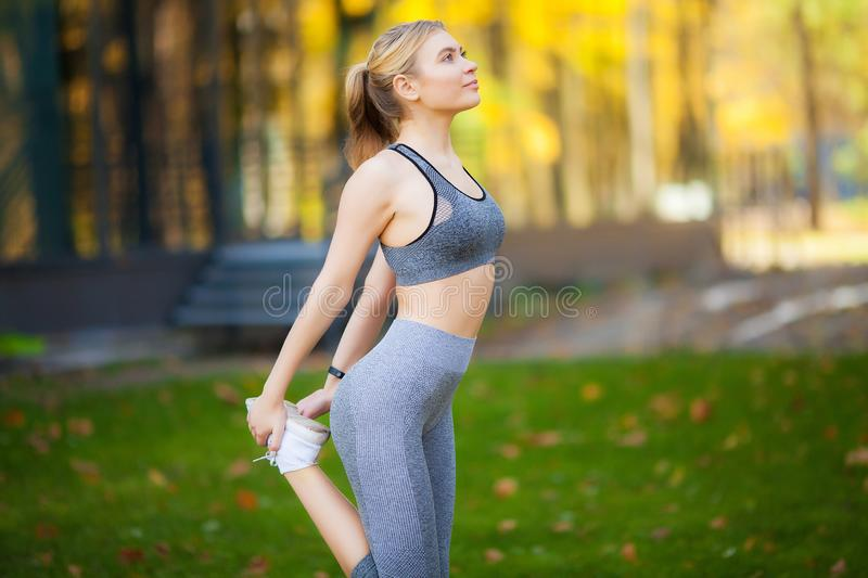 Fitness. Athlete girl, thlete exercise at outside, woman fitness. Young Beautiful Woman Stretching In The Park royalty free stock photography