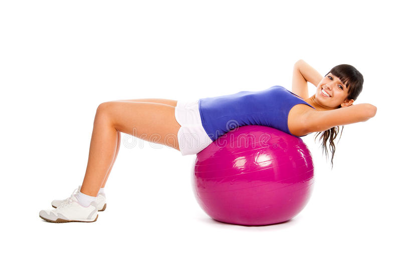 Fitness on the ball. Young girl doing fitness on the ball royalty free stock image