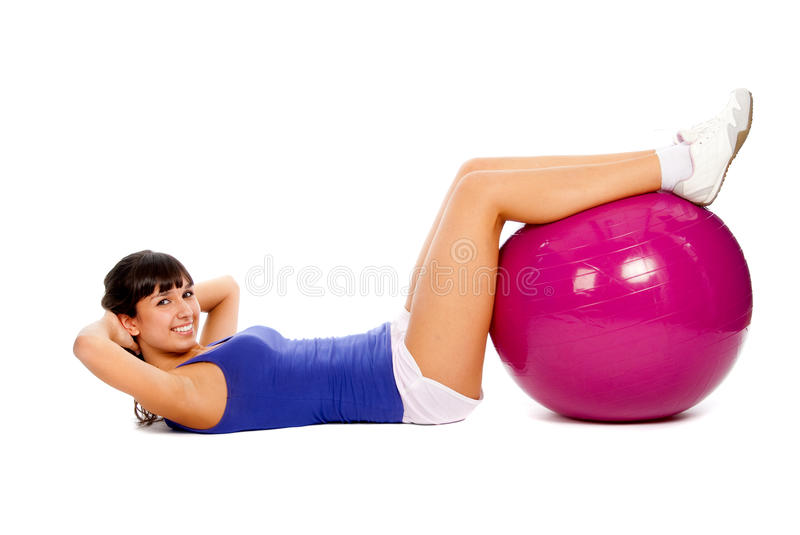 Fitness on the ball. Young girl doing fitness on the ball royalty free stock photos