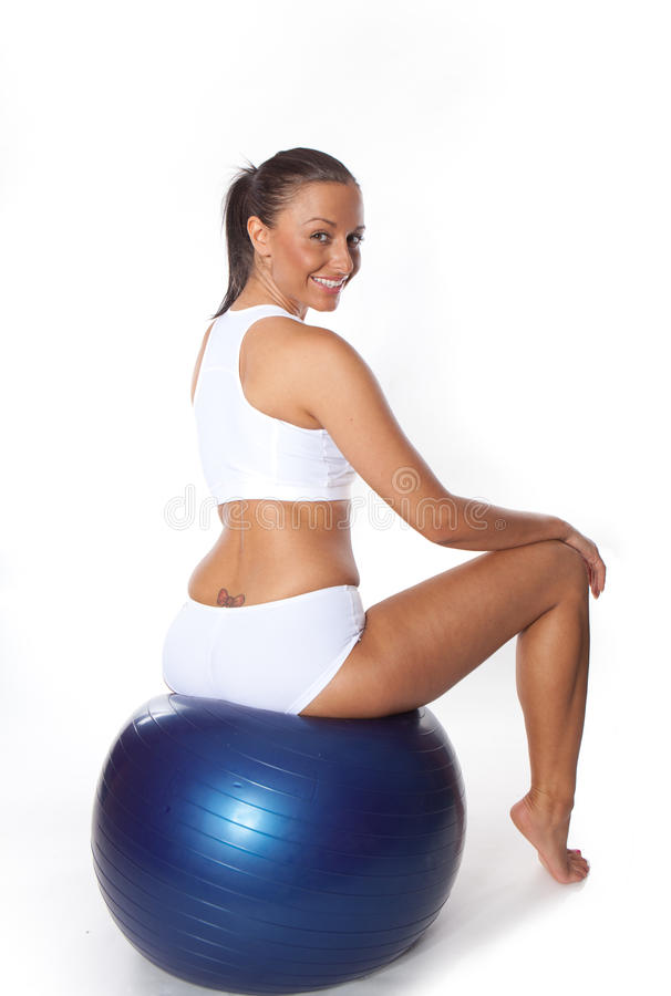 Fitness ball. Woman with fitness ball doing some Exercises royalty free stock images