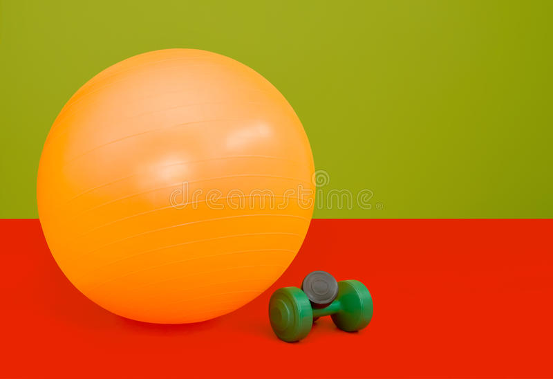 Fitness ball. Colorfull composition of Fitness ball and weights royalty free stock image