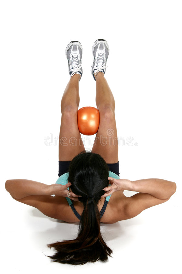 Fitness Ball. Woman doing crunches with fitness ball over white background stock images