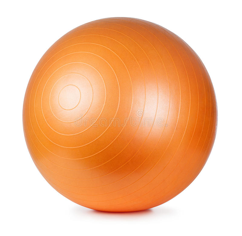 Fitness ball. Close up of an orange fitness ball isolated on white background stock photography