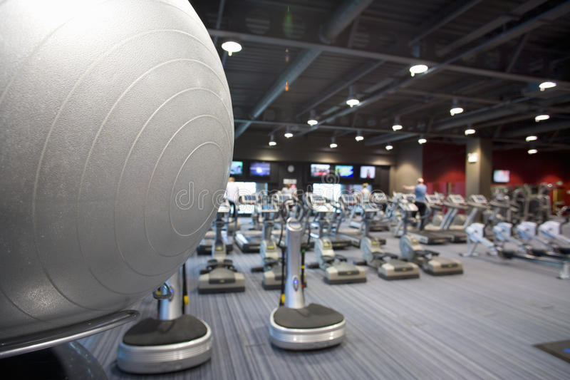 Fitness ball and exercise equipment in health club stock photography