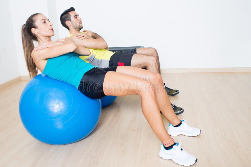 Fitness ball training. Two persons during functional training on fitness balls stock image