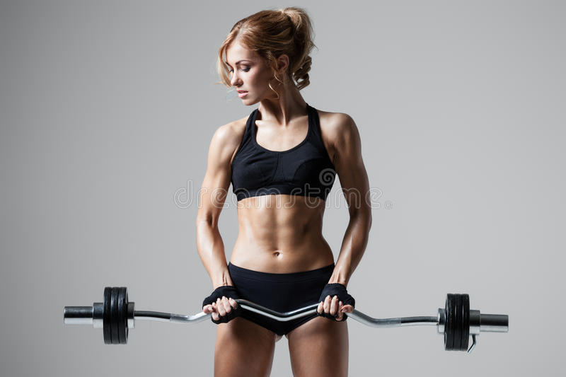 Fitness with barbell stock images