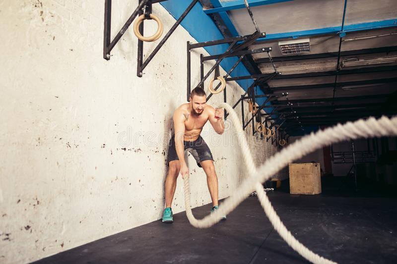 Fitness battling ropes at gym workout from big tires royalty free stock images
