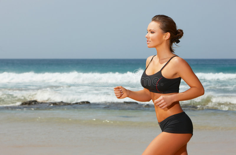 Fitness on beach stock images