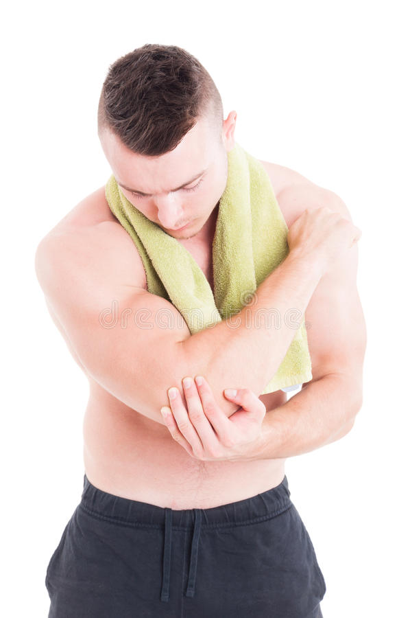 Fitness or bodybuilding trainer holding injured elbow stock photos