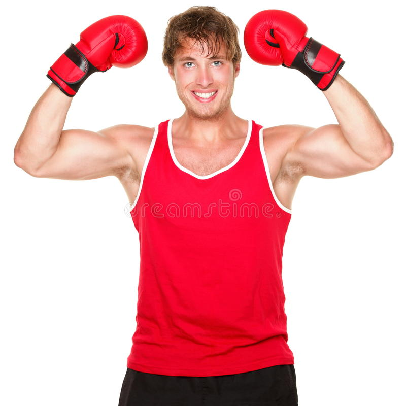Fitness boxing man. Showing strength flexing muscles. Handsome strong fit boxer smiling happy wearing red boxing gloves isolated on white background stock photos