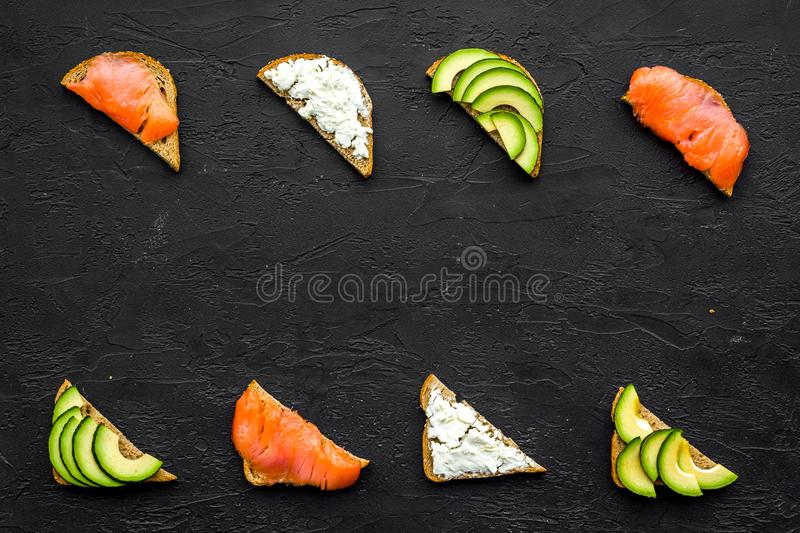 Fitness breskfast with homemade sandwiches on black background top view mockup stock photo