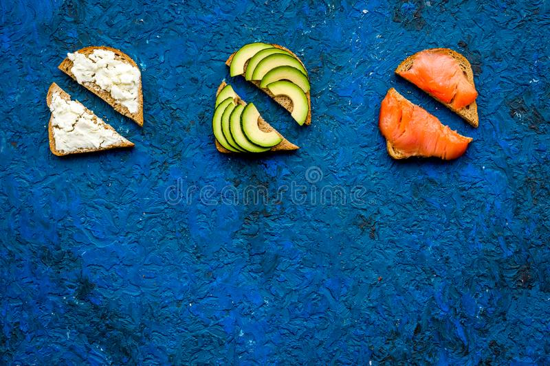 Fitness breskfast with homemade sandwiches on blue background top view mockup royalty free stock image