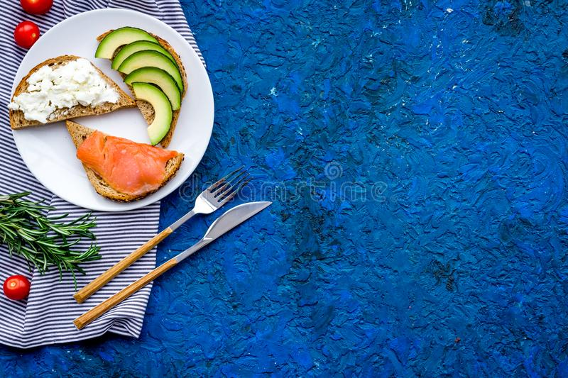 Fitness breskfast with homemade sandwiches on blue background top view mockup stock image