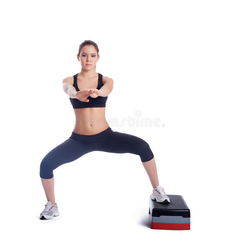 Fitness brunette woman with stepper. Isolated on white stock photos