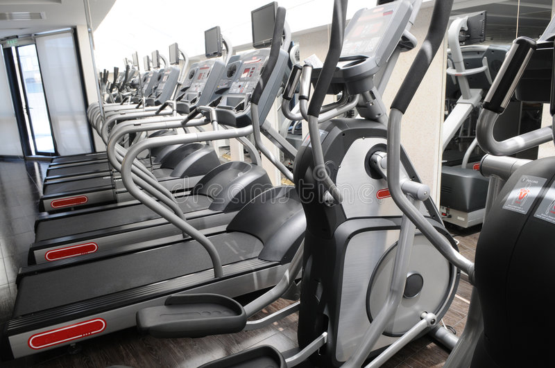 The fitness center. The fitness center with a lot of running machines royalty free stock photo