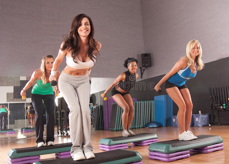 Fitness class. A group of friends in a step fitness class