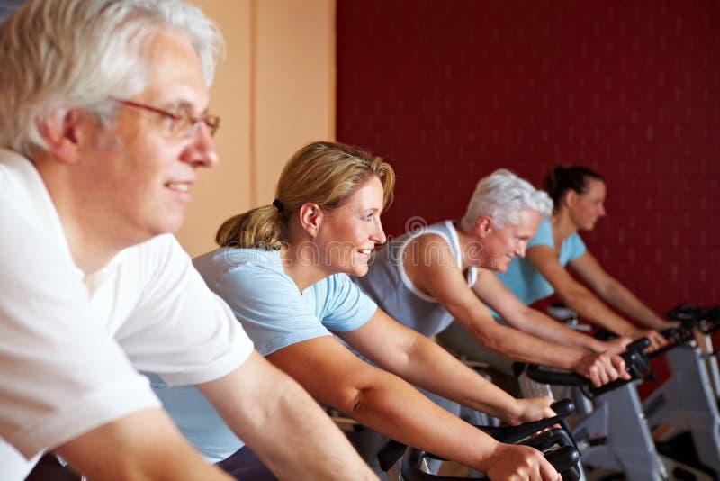 Fitness class on bikes
