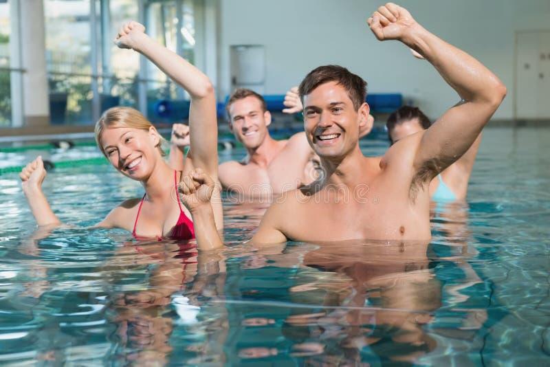 Fitness class doing aqua aerobics royalty free stock image
