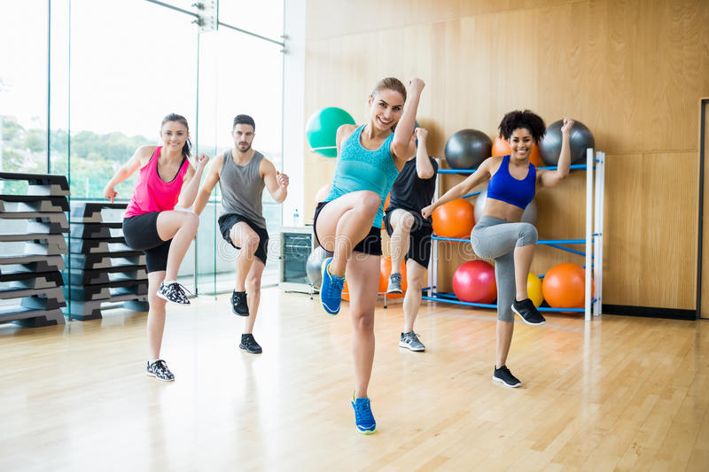 Fitness class exercising in the studio royalty free stock photos