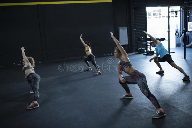 Fitness class in gym indoor training flexibility and elasticity royalty free stock photos