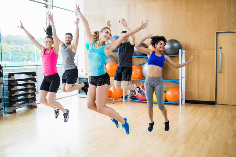 Fitness class jumping up in studio royalty free stock photos