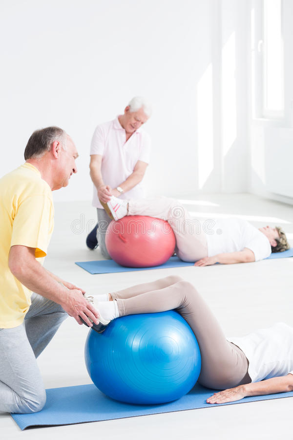 Fitness class for seniors stock images