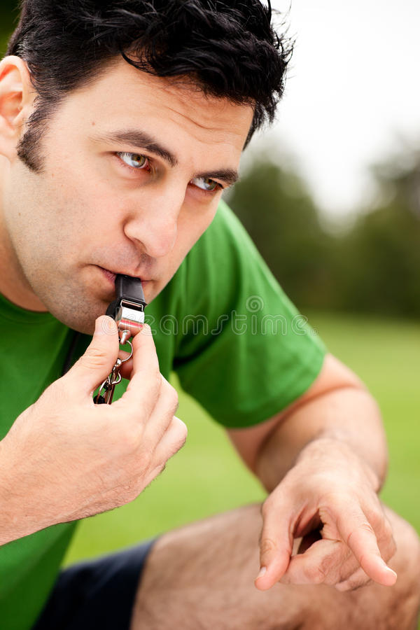 Download Fitness Coach Blowing Whistle And Pointing Stock Photo - Image: 22494222