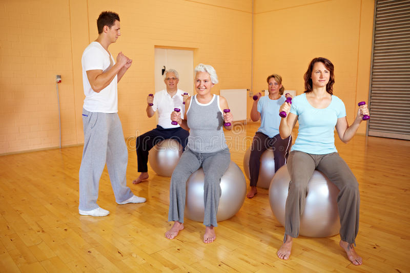 Fitness Coach Showing Dumbbell Royalty Free Stock Image