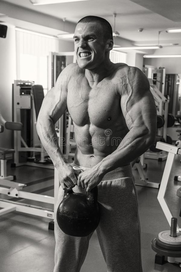 Fitness coach trains with dumbbells stock image