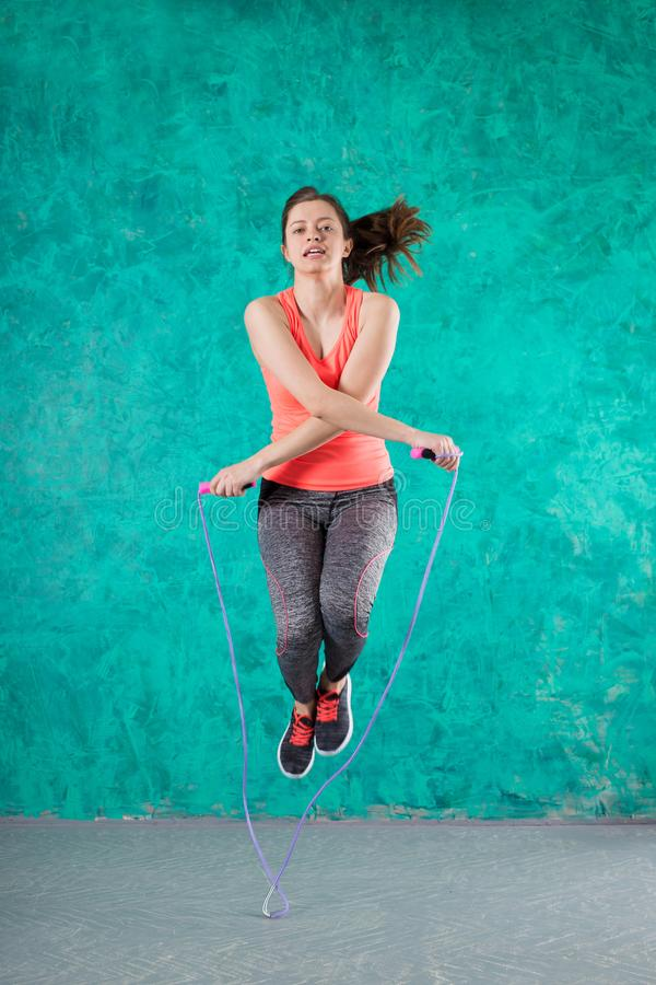 Fitness concept. Healthy lifestyle. oung slim woman jumping. royalty free stock photo
