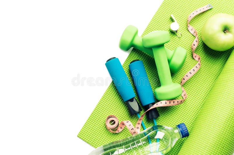 Download Fitness Concept - Yoga Mat, Apple, Dumbbells And Skipping Rope Stock Photo - Image: 83709889