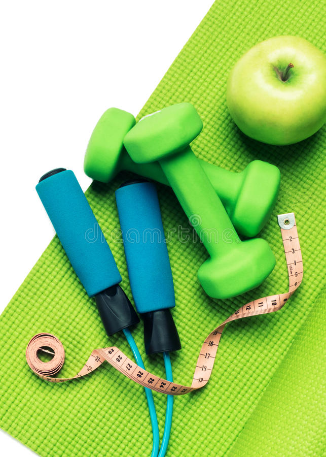 Download Fitness Concept - Yoga Mat, Apple, Dumbbells And Skipping Rope Stock Photo - Image: 83710752
