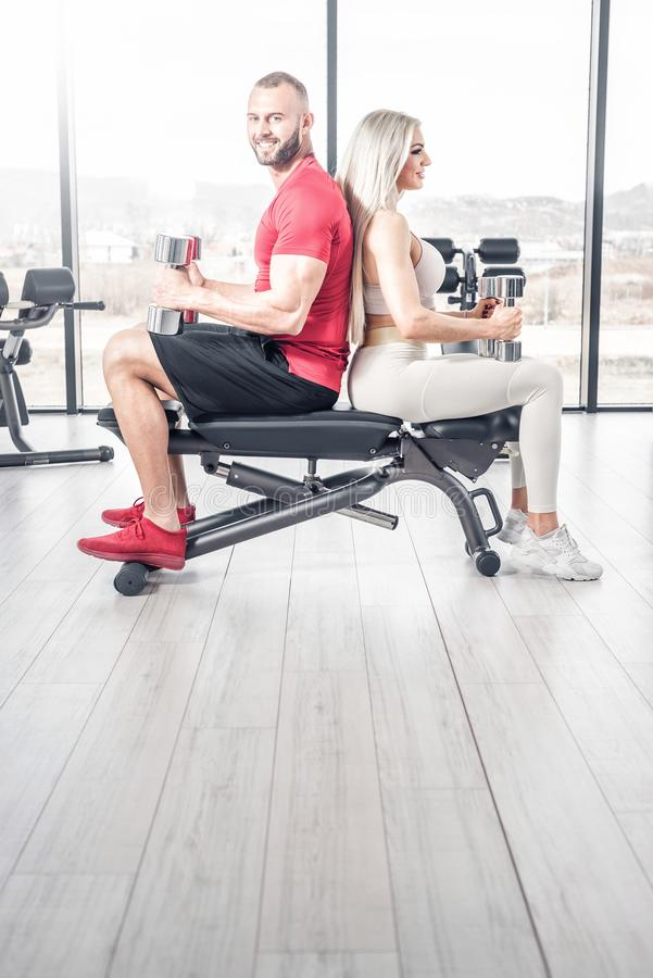 Fitness couple exercise with dumbbells royalty free stock photography