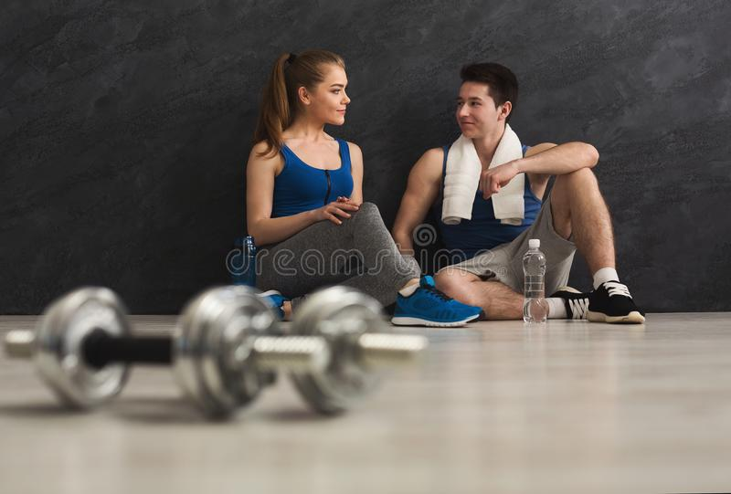 Fitness couple at gym royalty free stock photo