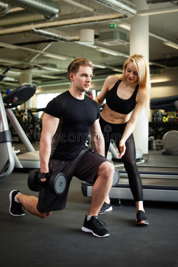 Fitness couple in gym. Fitness couple making exercies in a gym stock photography