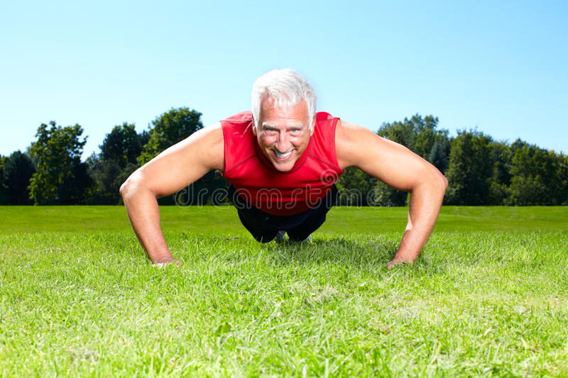 Fitness couple. Happy senior fitness couple in the park royalty free stock image