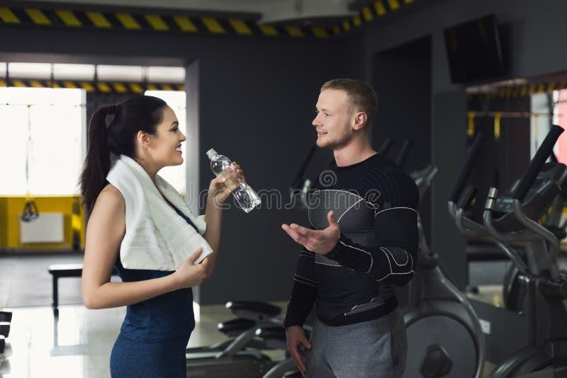 Fitness couple having break at gym royalty free stock photos