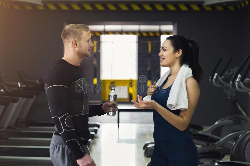 Fitness couple having break at gym stock images