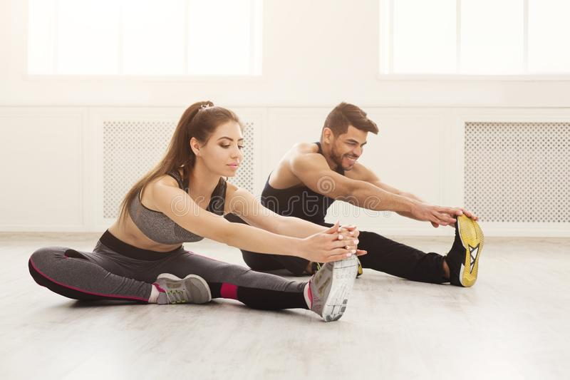Fitness couple at stretching training indoors royalty free stock photo