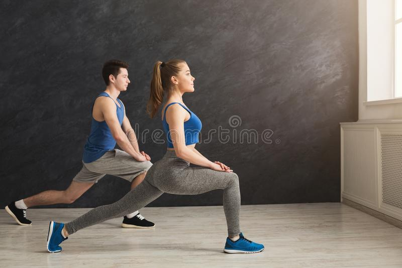Fitness couple warmup stretching training indoors royalty free stock photo