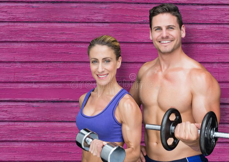 fitness couple with wights with pink wood background stock illustration