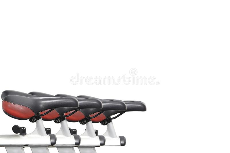 Fitness cycle saddles stock photography